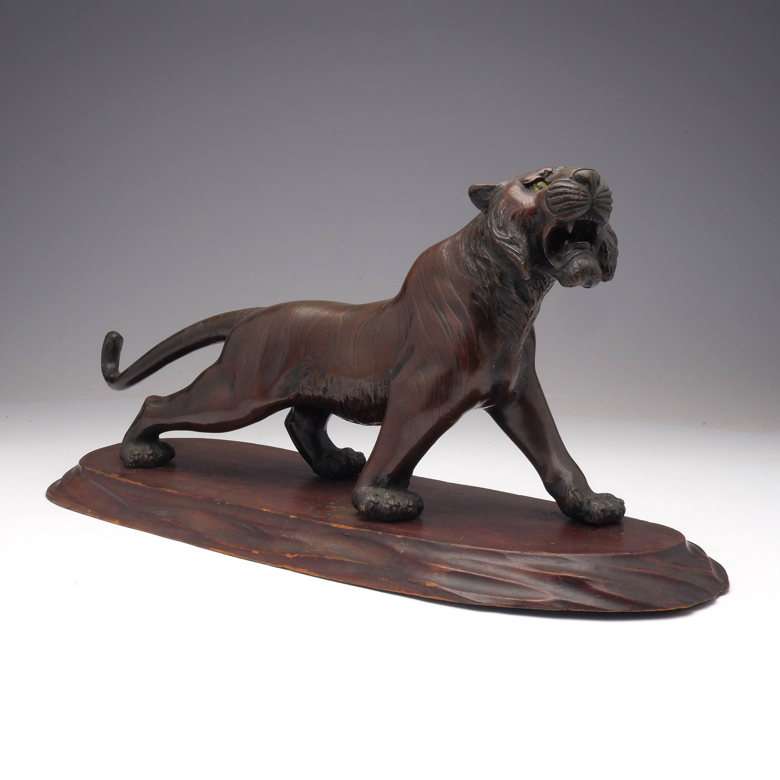 'Japanese Patinated Bronze Model of a Stalking Tiger on a Carved Wood Base, Meiji Period 1868-1912'