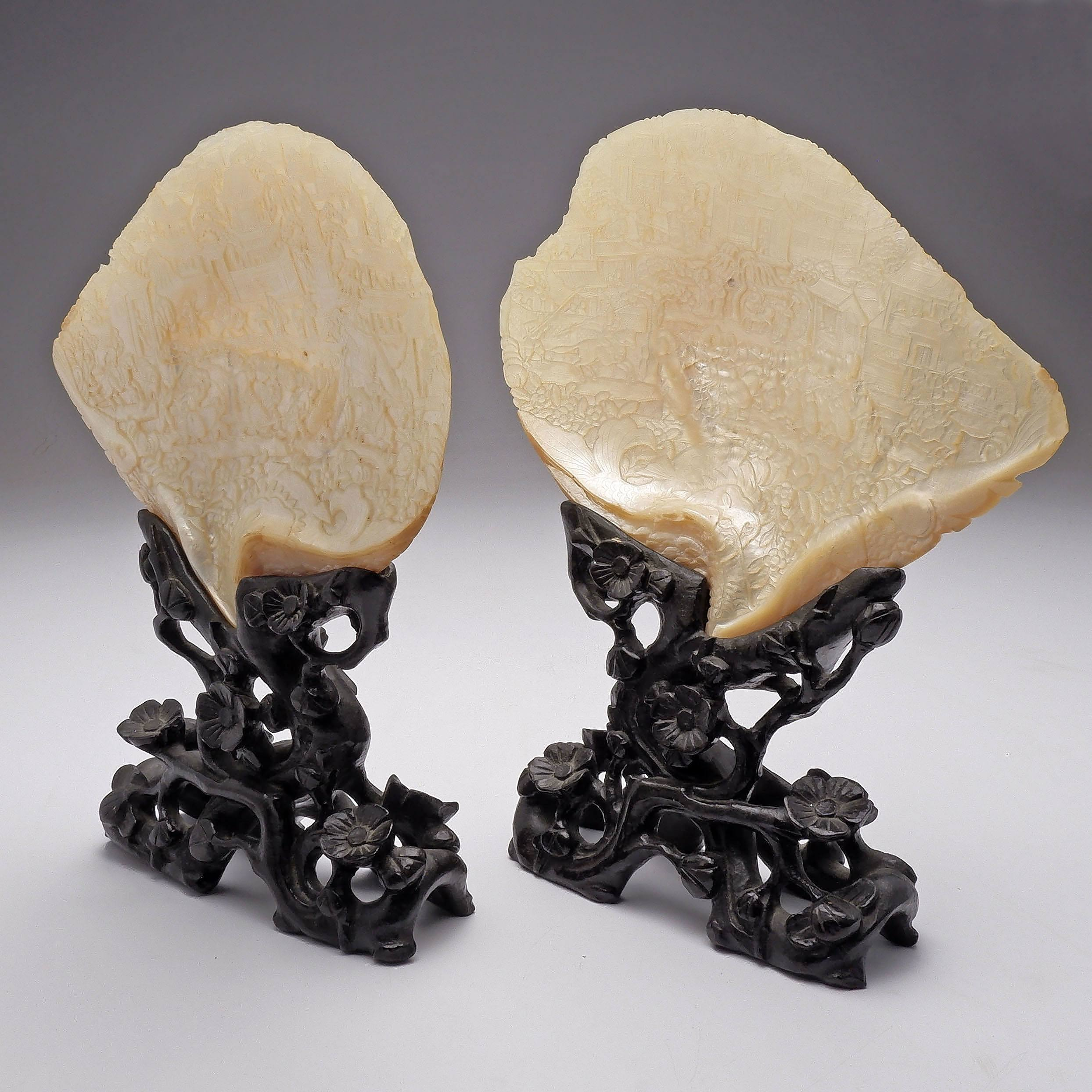 'Pair of Chinese Carved Mother of Pearl Shells on Hardwood Stands'