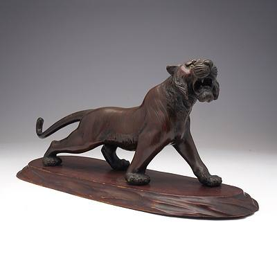 Japanese Patinated Bronze Model of a Stalking Tiger on a Carved Wood Base, Meiji Period 1868-1912