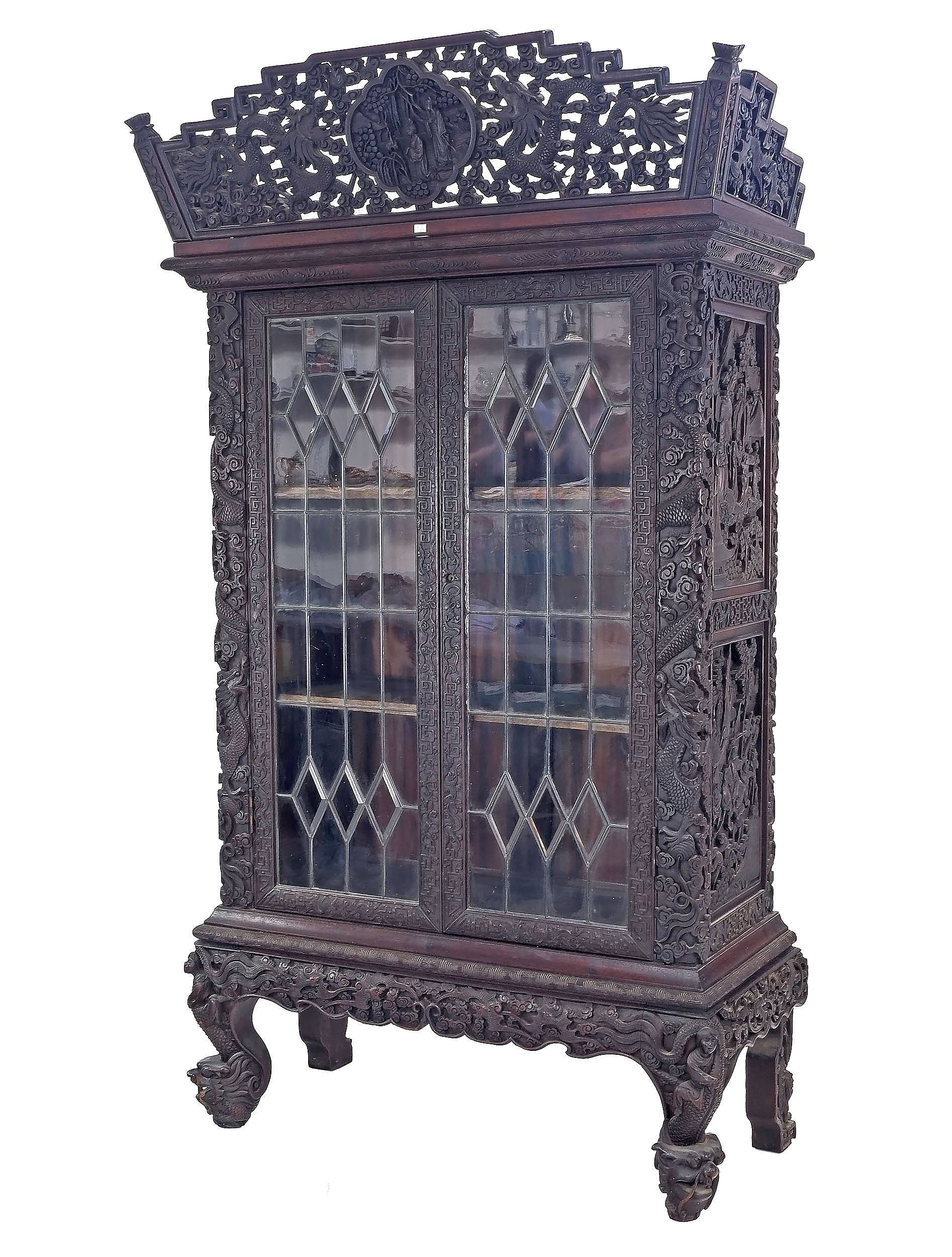 'Impressive Antique Chinese Export Hardwood Display Cabinet Profusely Carved with Dragons and Bats in Clouds, Circa 1900'