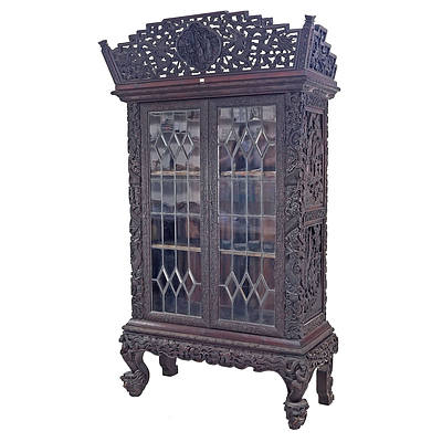Impressive Antique Chinese Export Hardwood Display Cabinet Profusely Carved with Dragons and Bats in Clouds, Circa 1900