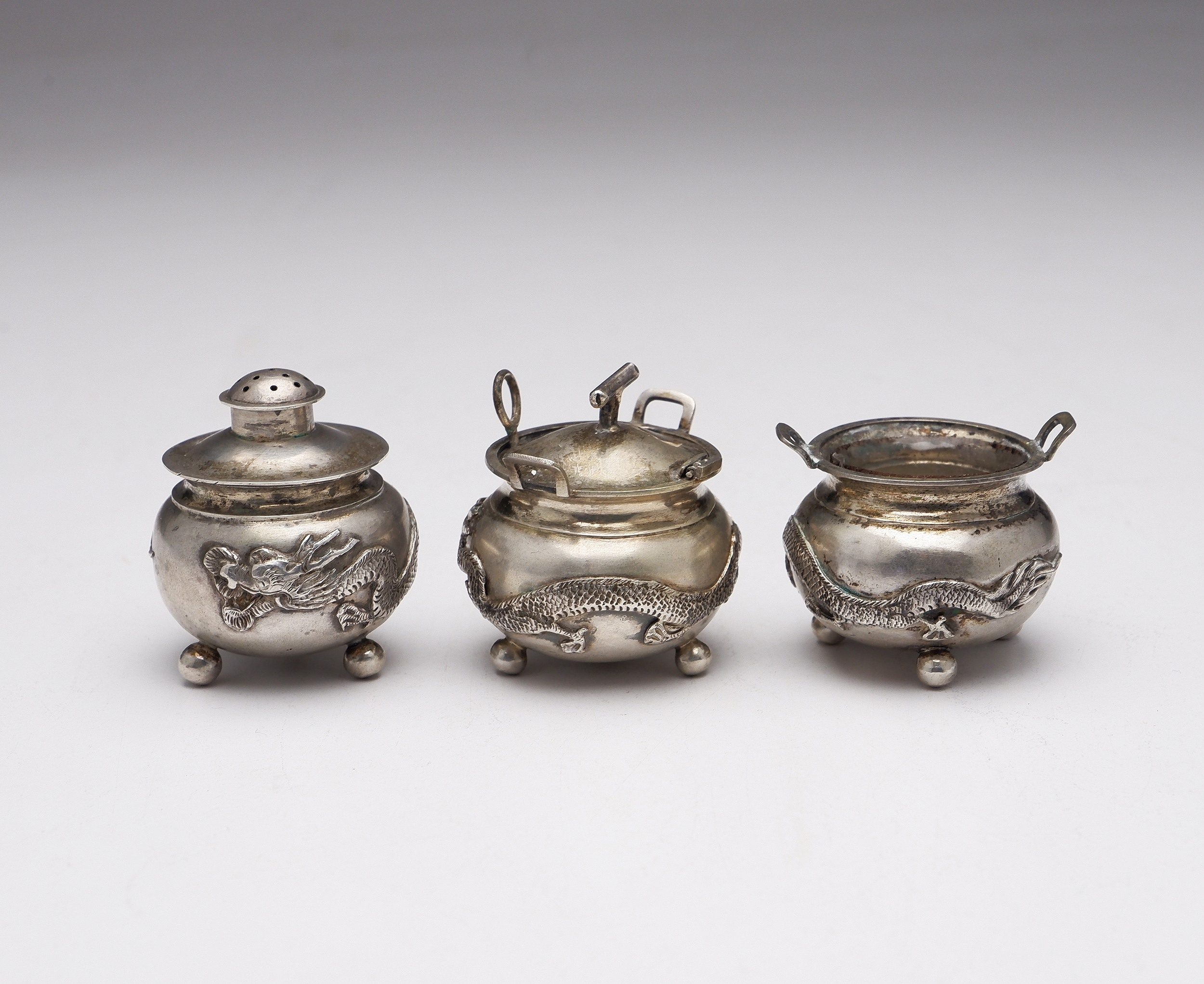 'Chinese Export Silver Three Piece Condiment Set with Four Claw Dragons'