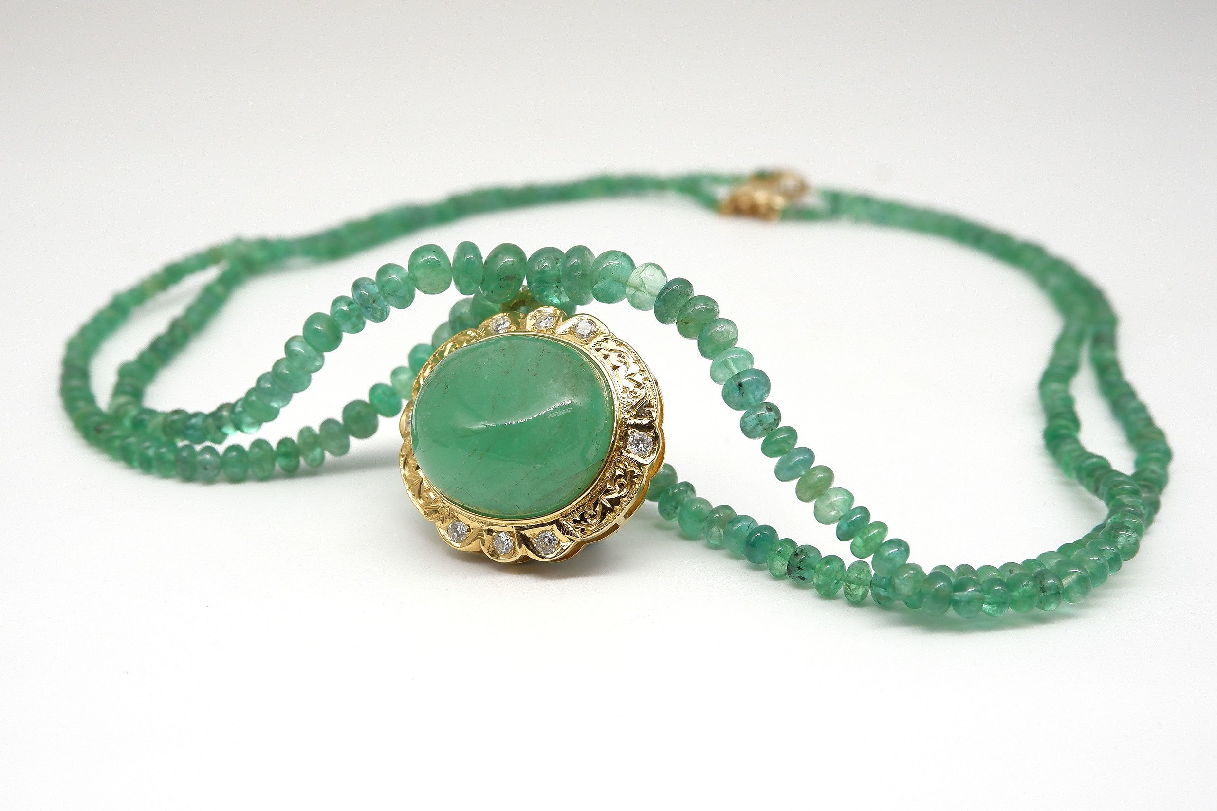 'Impressive Gold and Diamond Set 50ct Emerald Cabochon Pendant on an Emerald Beaded Necklace'