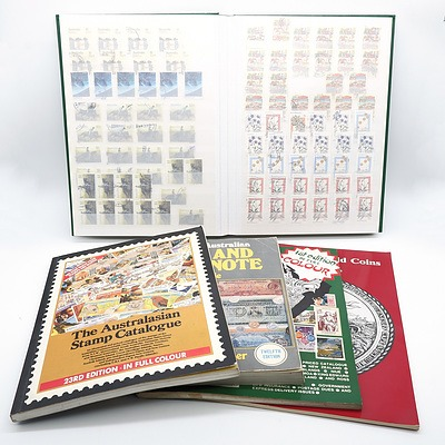 Four Stamp Collecting Reference Books and Stamp Album