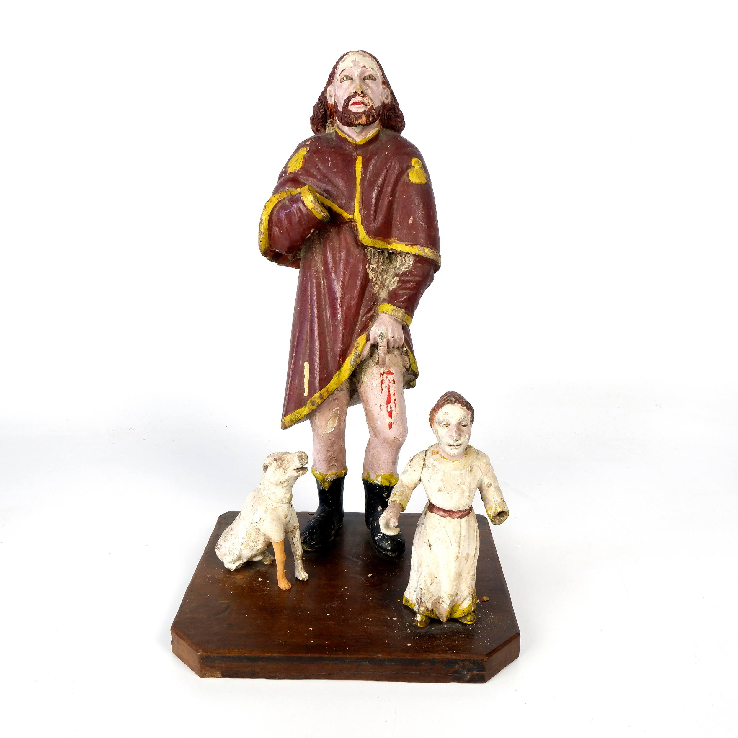 'Antique Philippino Hand Carved and Painted Santos Figure of Saint Roch Wearing Pilgrimage Garb and Pointing to a Lesion on his Thigh, Late 19th to Early 20th Century'