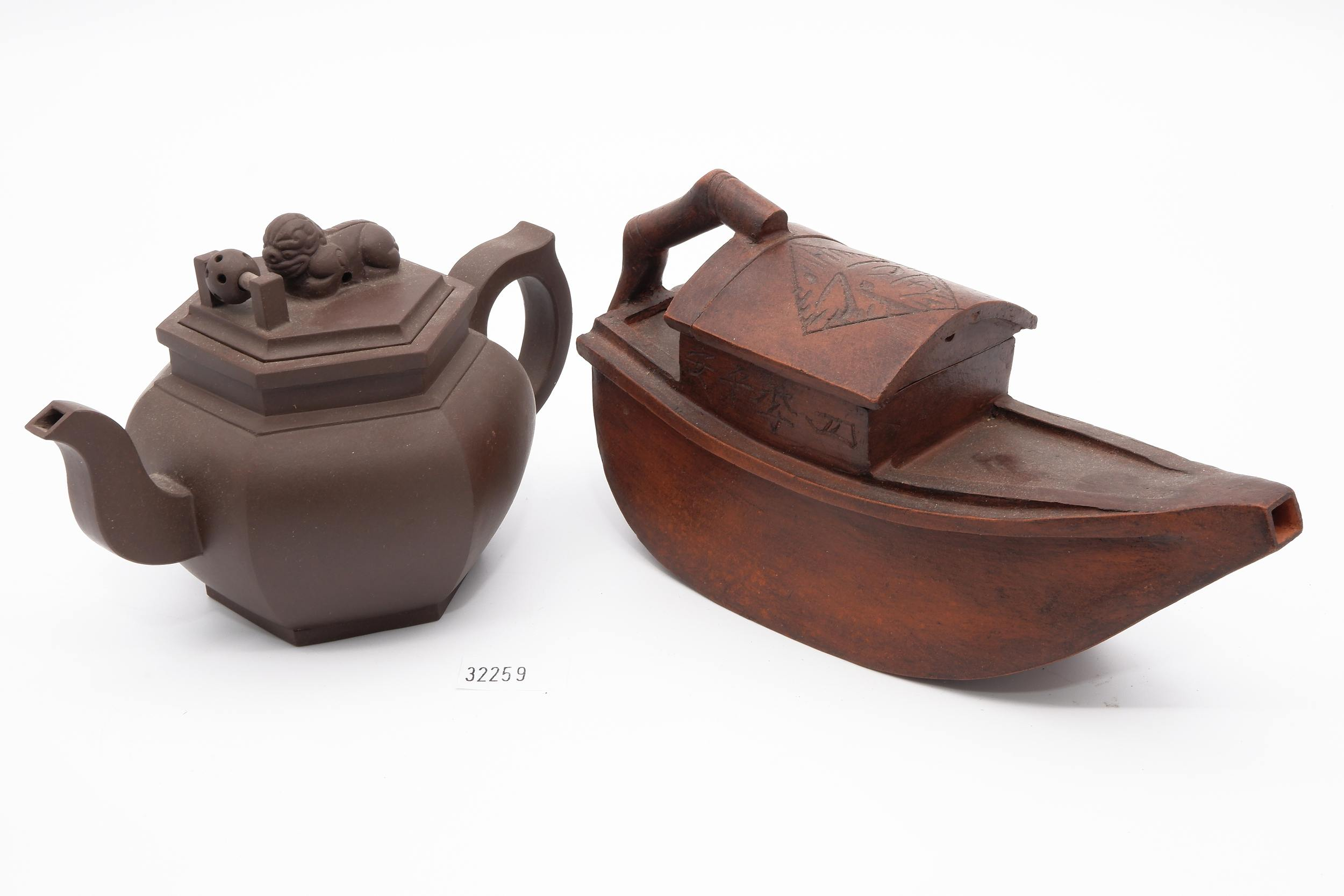'Two Chinese Yixing Pottery Teapots Including Boat Shaped'