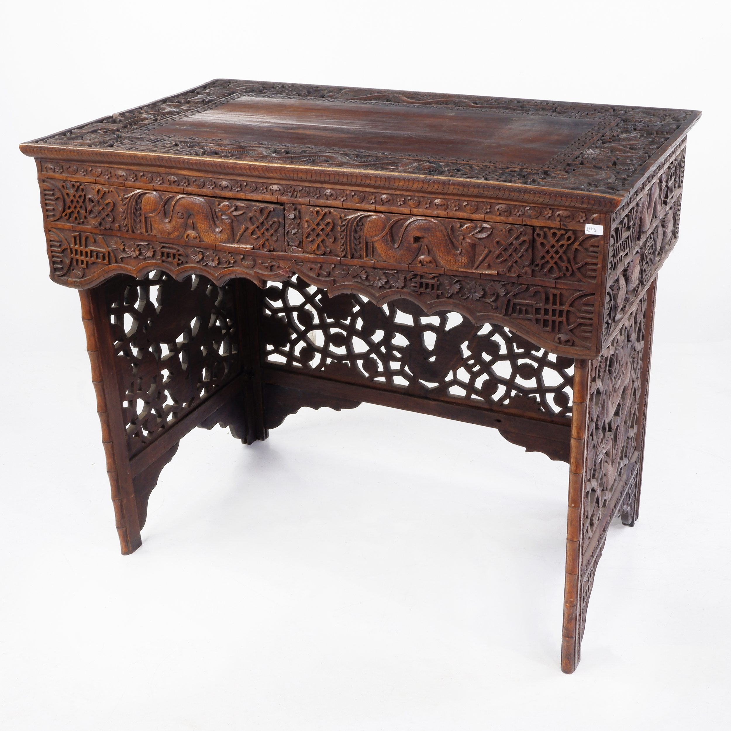 'South Chinese or Burmese Teak Campaign Desk Profusely Carved with Dragons and Auspicious Symbols, Circa 1900'