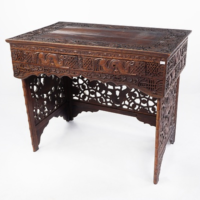 South Chinese or Burmese Teak Campaign Desk Profusely Carved with Dragons and Auspicious Symbols, Circa 1900