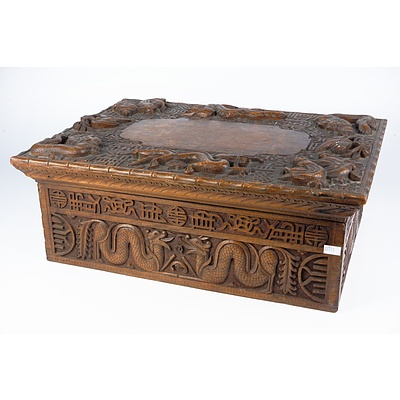 South Chinese or Burmese Teak Writing Box Profusely Carved with Dragons and Auspicious Symbols, Circa 1900