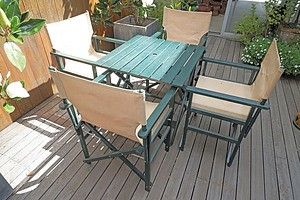 A Painted Timber Outdoor Table Together with Four Canvas Director's Chairs