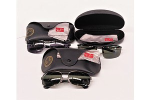 Three Sets Sunglasses In Cases Marked Ray Ban