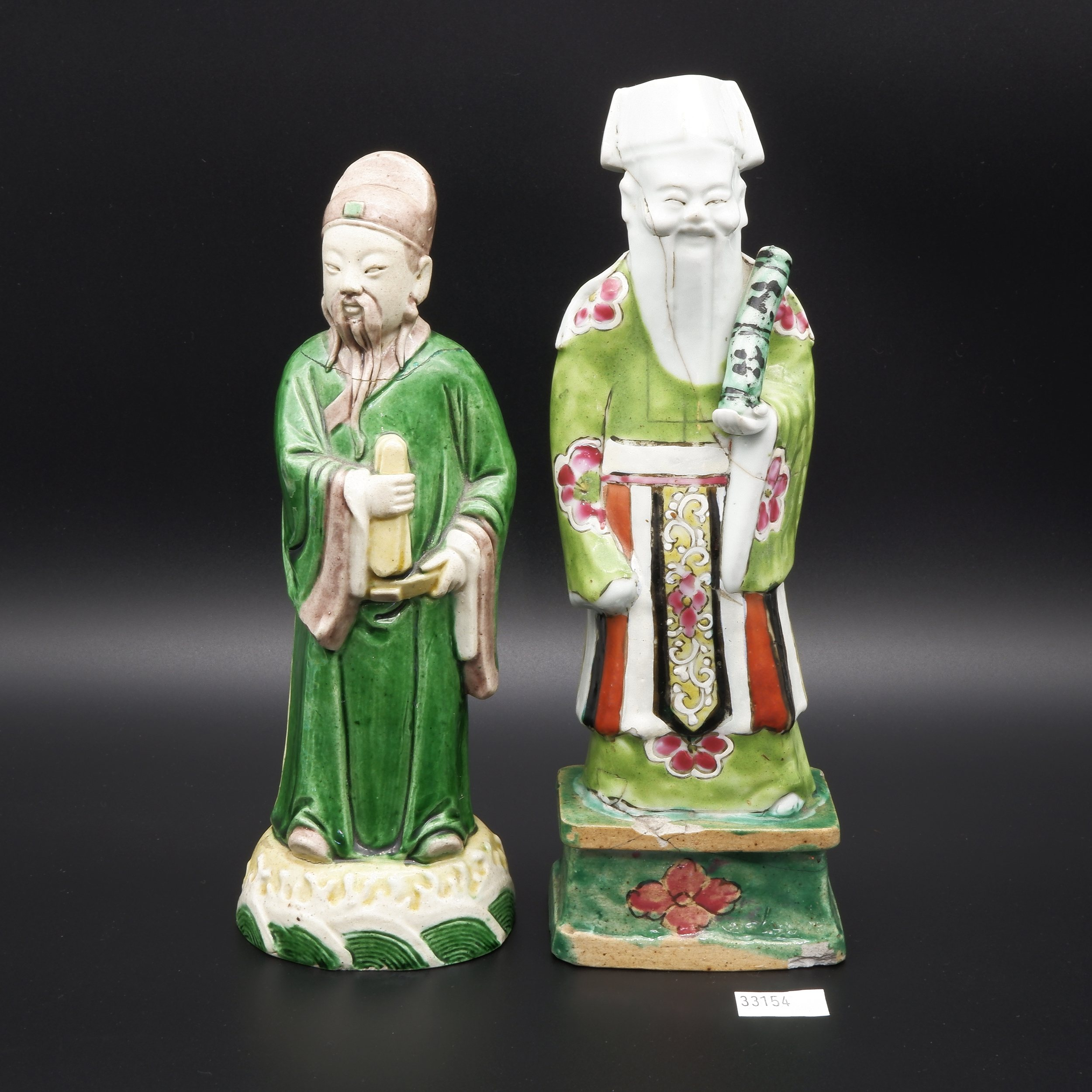 'Two 18th Chinese Famille Verte Glazed Biscuit Porcelain Models of Daoist Immortals'