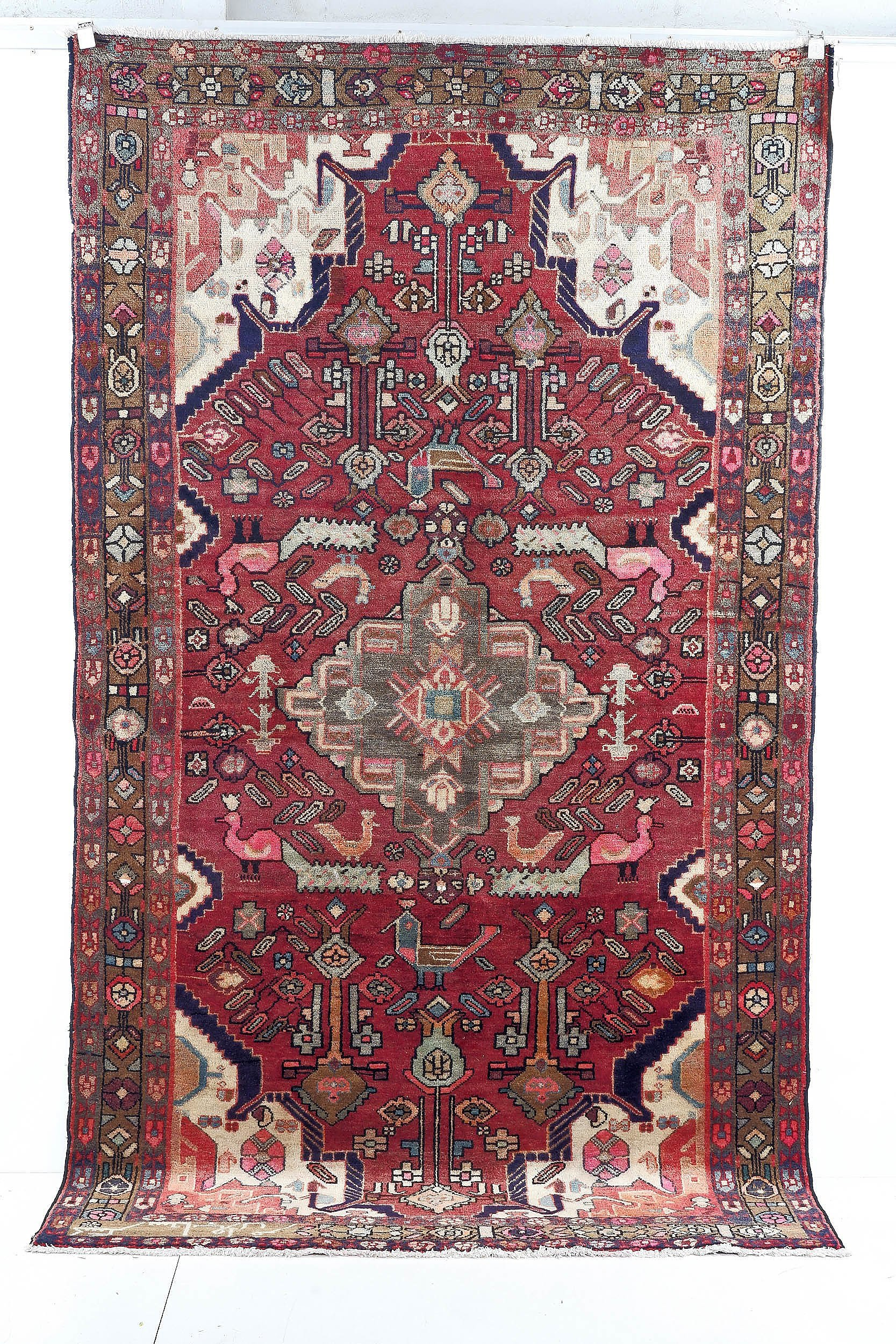 'Persian Nahavad Hand Knotted Wool Pile Rug with Diamond Central Medallion and Floral and Bird Design on a Red Ground'