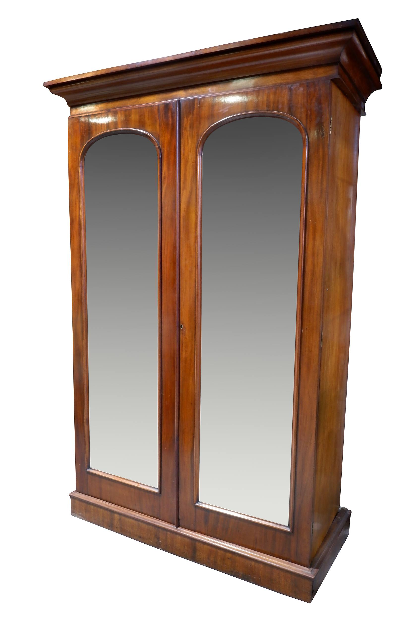 'Victorian Flame Mahogany Wardrobe with Arched Mirrored Doors, Circa 1880'