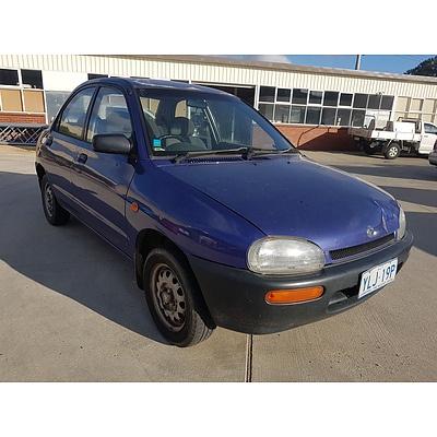 7/1994 Mazda 121   4d Sedan Purple 1.3L