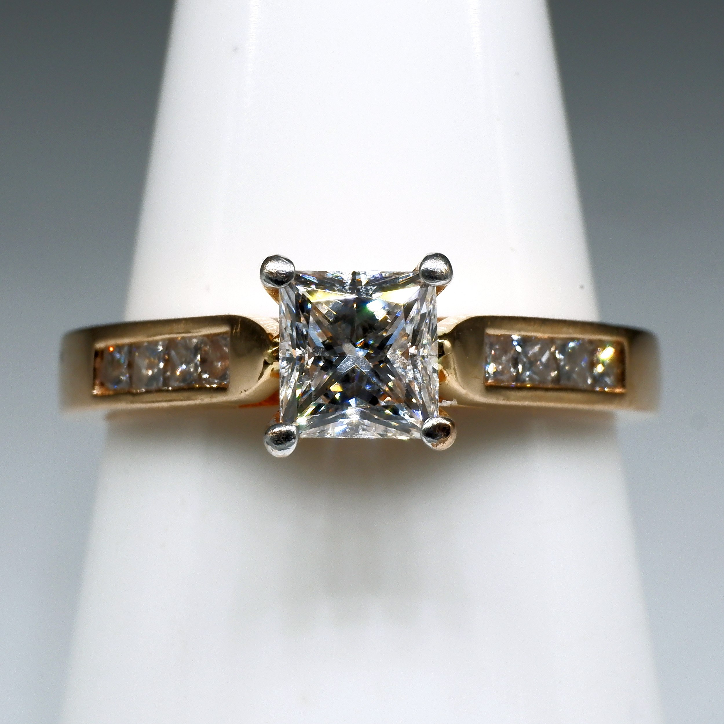 '18ct Rose Gold Ring with Princess Cut Diamond 0.51ct (G VS2) with Four Princess Cut Diamonds on Either Side'