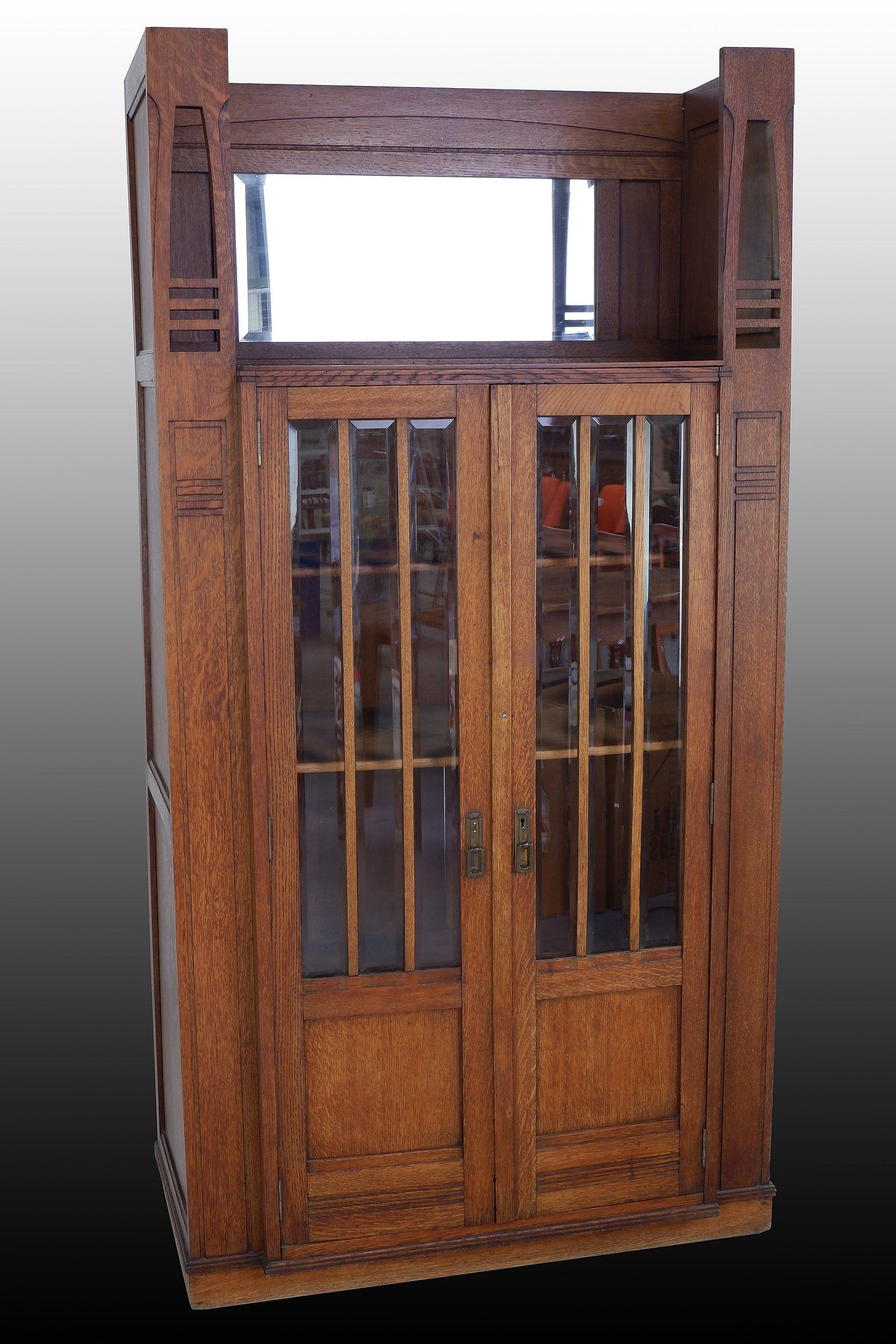 'Belgium Secessionist Full Oak Cabinet with Heavily Beveled Glass Panel Doors and Mirrored Back in Open Section Top - Circa 1910s'