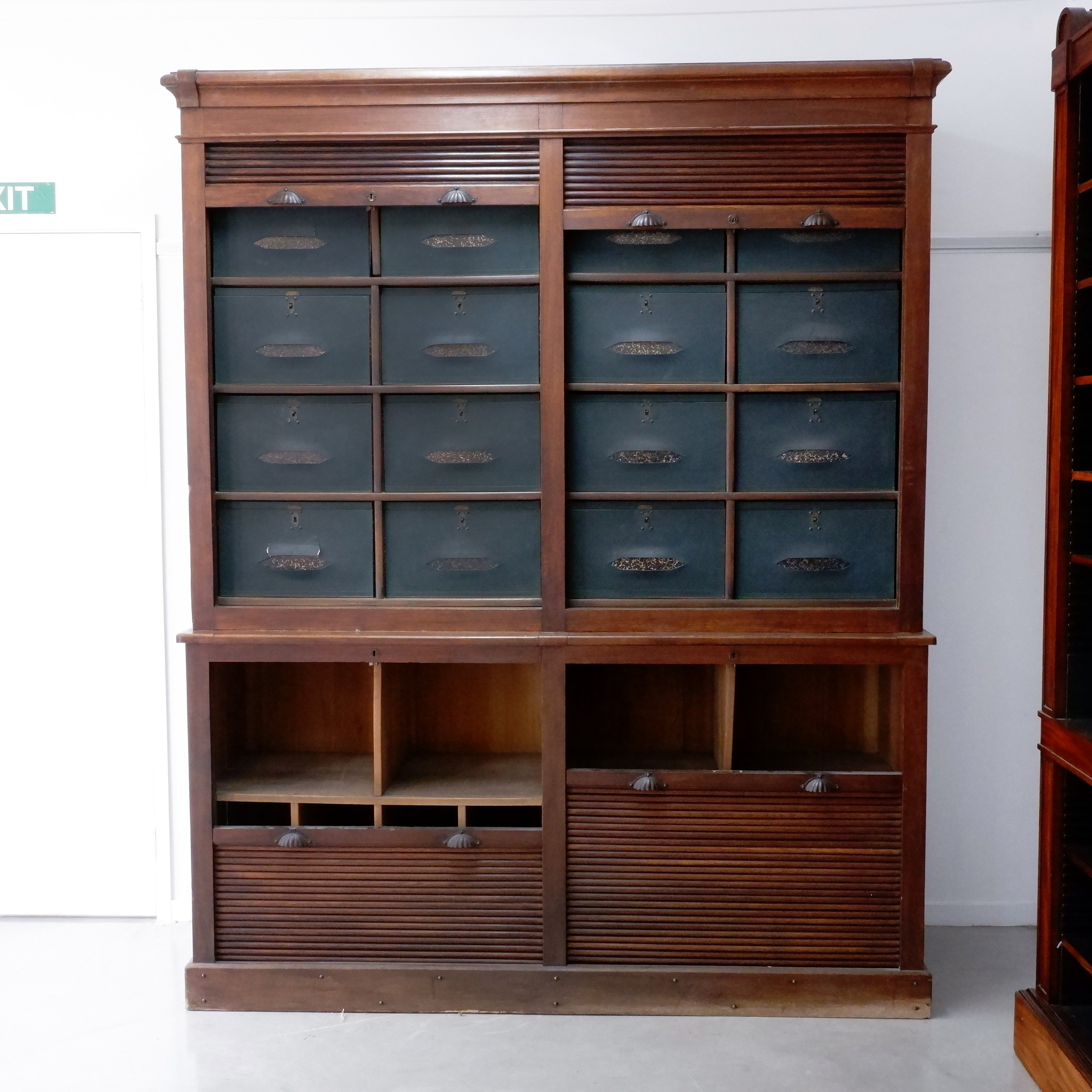 'An Antique Oak Shop Cabinet of Grand Proportions with Tambour Doors and Fitted Sections Above and Below'