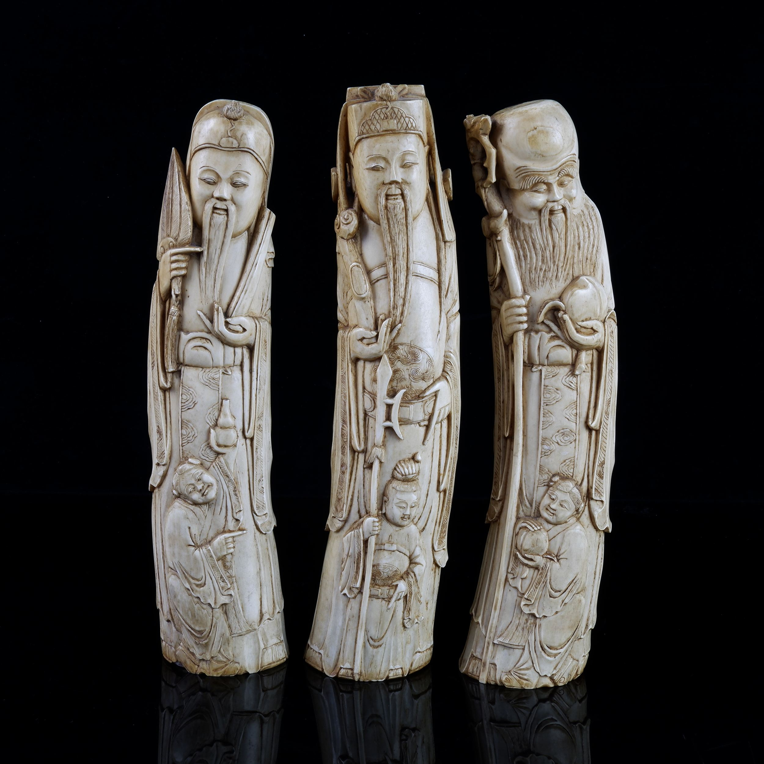 'Fine Set of Three Chinese Qing Dynasty Carved Ivory Immortals, 19th Century'