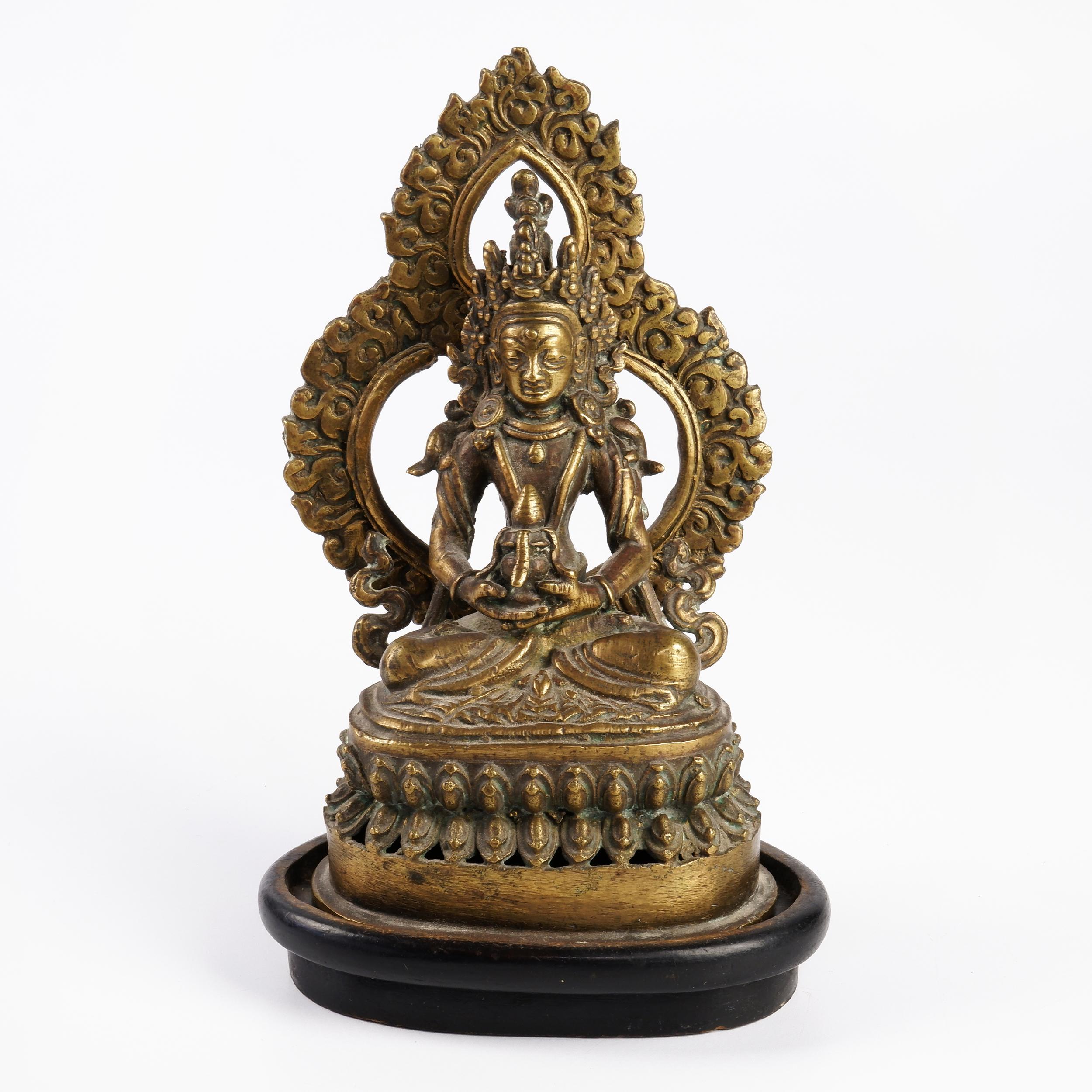 'Cast Bronze Figure of Buddha Amitayus Seated Beneath a Flaming Mandorla on a Double Lotus Base'