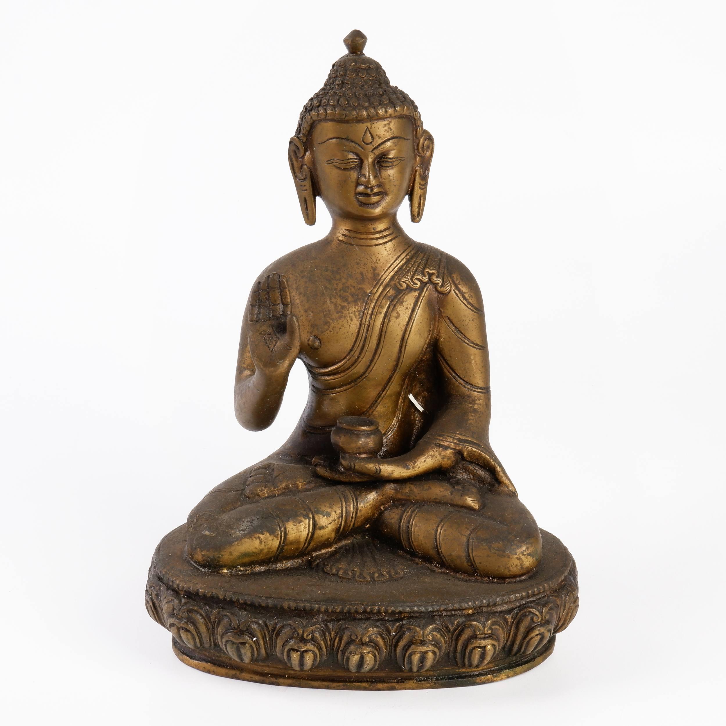 'Cast Bronze Figure of Buddha Shakyamuni with Alms Bowl and Third Eye Seated on a Lotus Base'