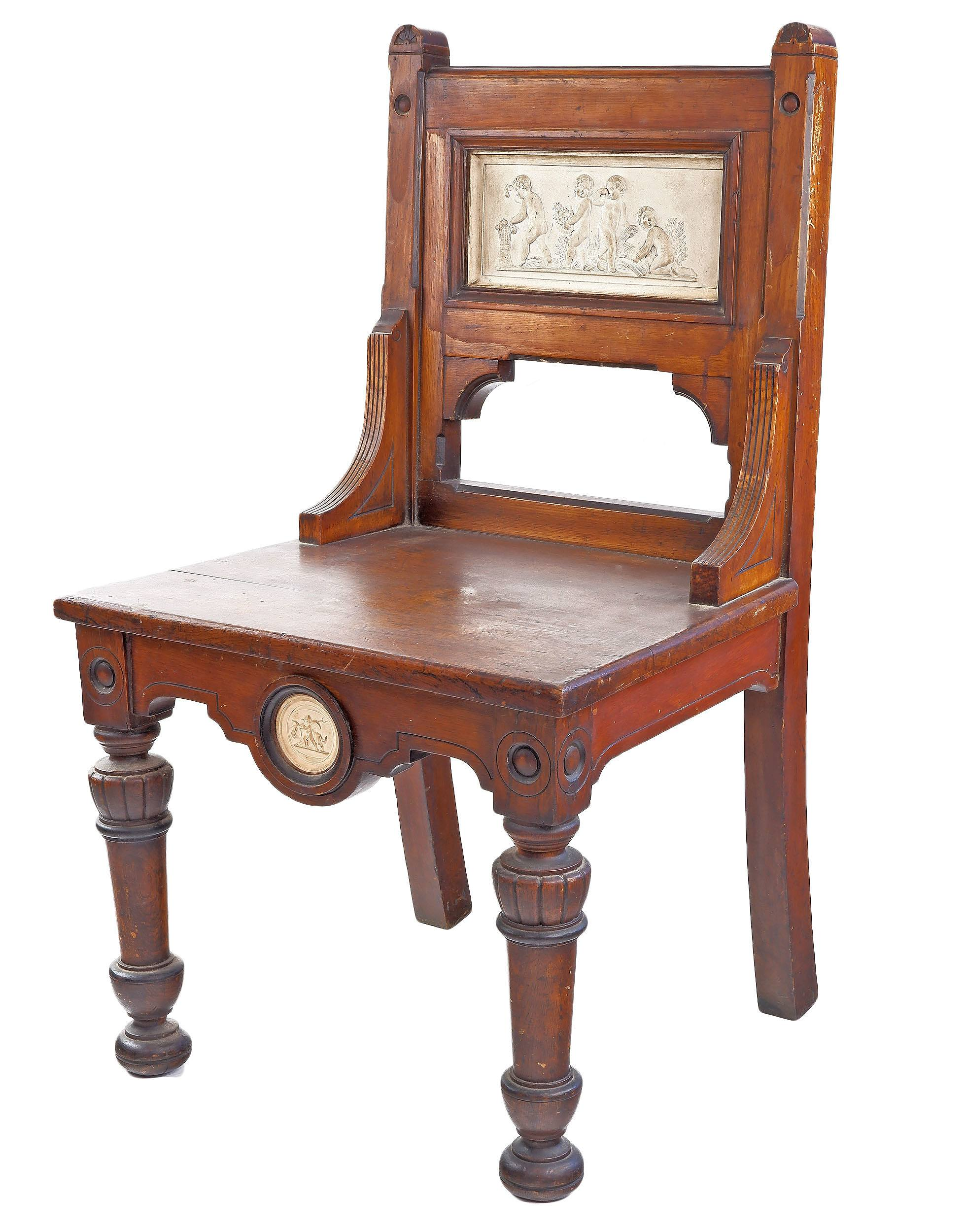 'English Gothic Revival Mahogany Hall Chair Inset with Bas Relief Ceramic Plaques, Late 19th Century'