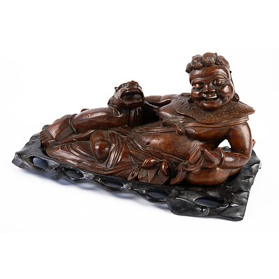 Large Antique Chinese Hardwood Carving of a Reclining Sage, Late 19th to Early 20th Century