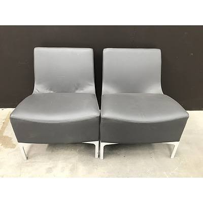 Pair Of PLUS Brown Leather Chairs