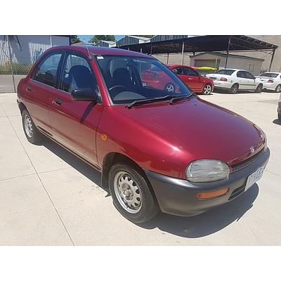 12/1994 Mazda 121 4d Sedan Maroon 1.3L