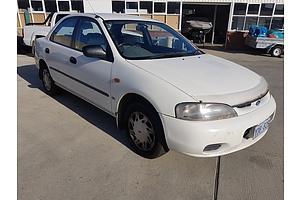 1/1996 Ford Laser LXi KJ 4d Sedan White 1.8L