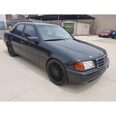 3/1997 Mercedes-Benz C200 Espirit W202 4d Sedan Black 2.0L