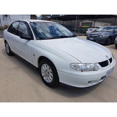 2/2001 Holden Commodore Lumina VX 4d Sedan White 3.8L