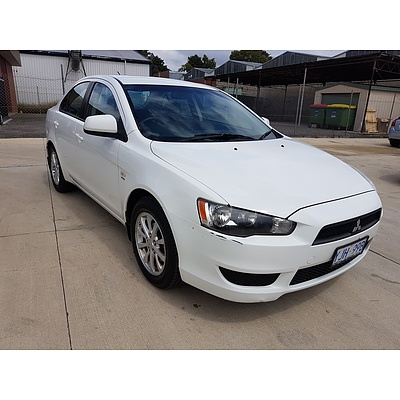 6/2010 Mitsubishi Lancer ES CJ MY10 4d Sedan White 2.0L