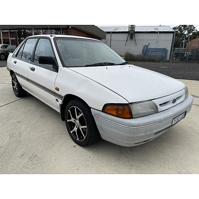 5/1994 Ford Laser GL KHII 4d Sedan White 1.6L