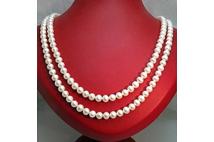 Double Strand of very long Cultured Pearls, strung to SILVER Clasp