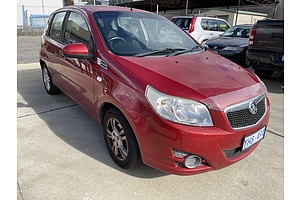 2/2012 Holden Barina Classic TK MY11 5d Hatchback Red 1.6L