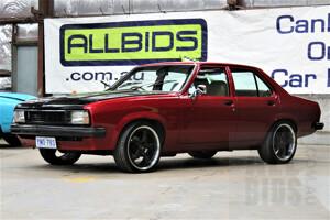 8/1980 Holden Torana UC 4d Sedan Candy Red 5.0L V8 Turbo