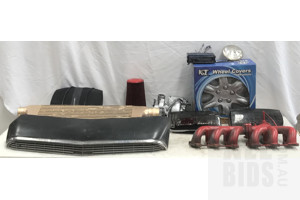 Assorted Motor Vehicle Accessories, Including Driving And Head Light Assembly, Creddy Intercooler, 14 Inch KT Wheel Covers And Straight Six Exhaust Manifold